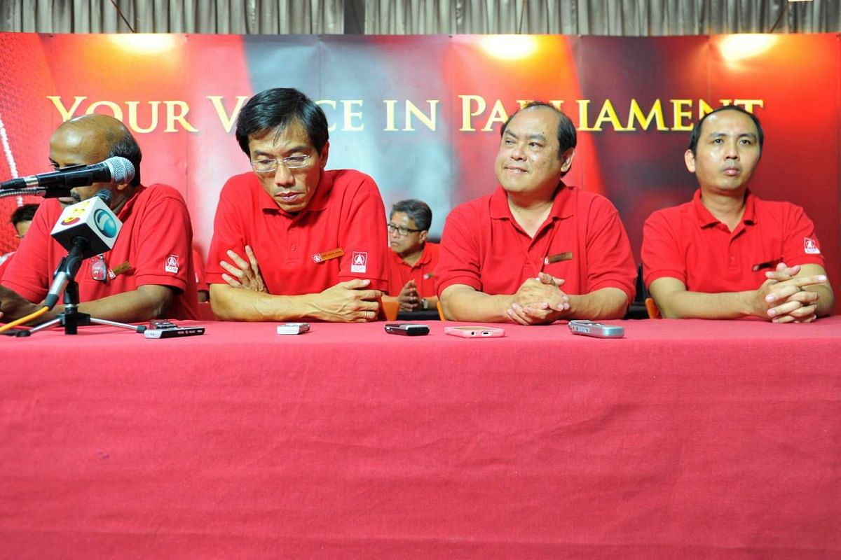 The Singapore Democratic Party's Chee Soon Juan (second from left) and his teammates at a press conference. The SDP failed to make any inroads in this election.