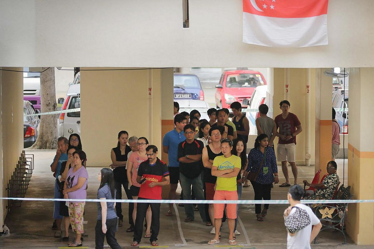 Singaporeans waiting in line to cast their vote at a polling station on Sept 11, 2015.