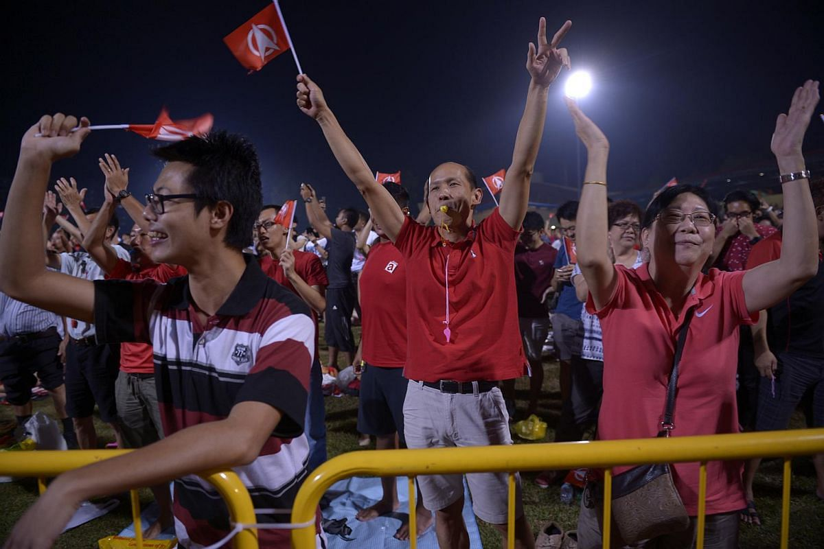 Supporters of the Singapore Democratic Party cheering at the party's rally at Woodlands Stadium.