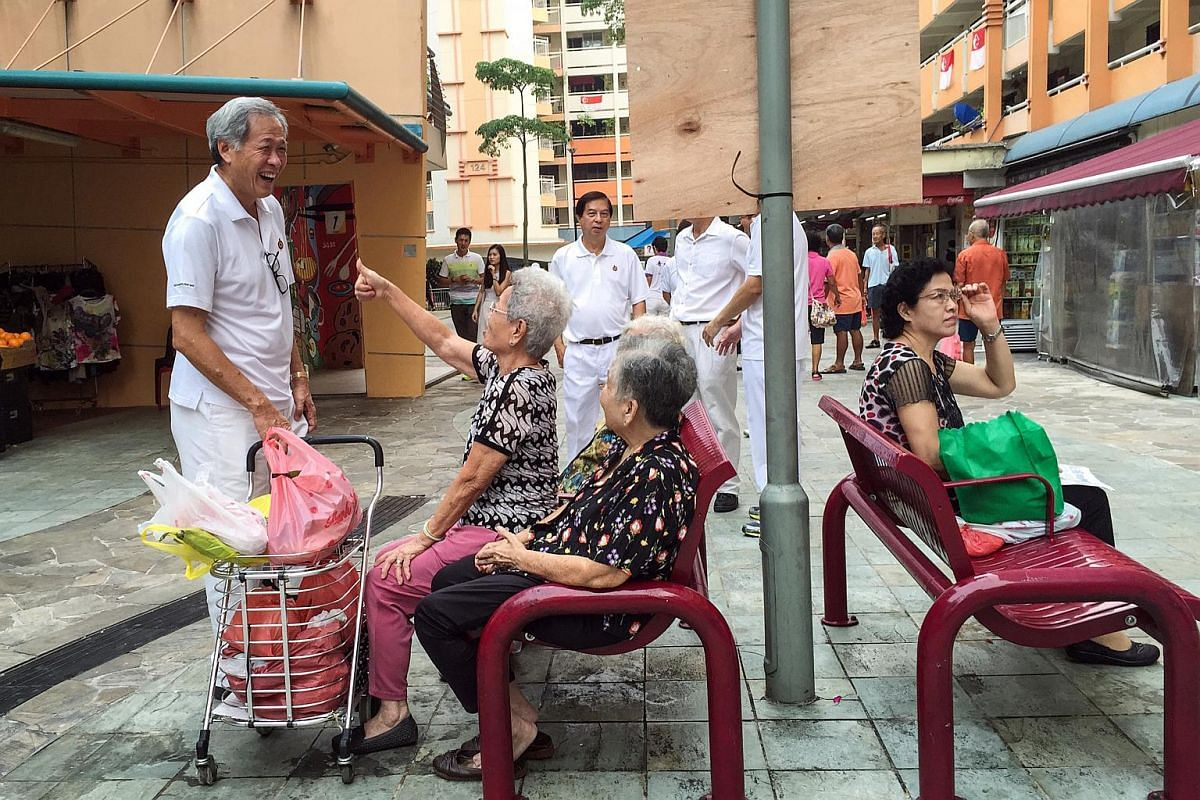 People's Action Party's candidate and anchor for Bishan-Toa Payoh GRC Dr Ng Eng Hen chatting with residents outside the market and food centre at Block 127 Toa Payoh Lorong 1 on Sept 8, 2015.
