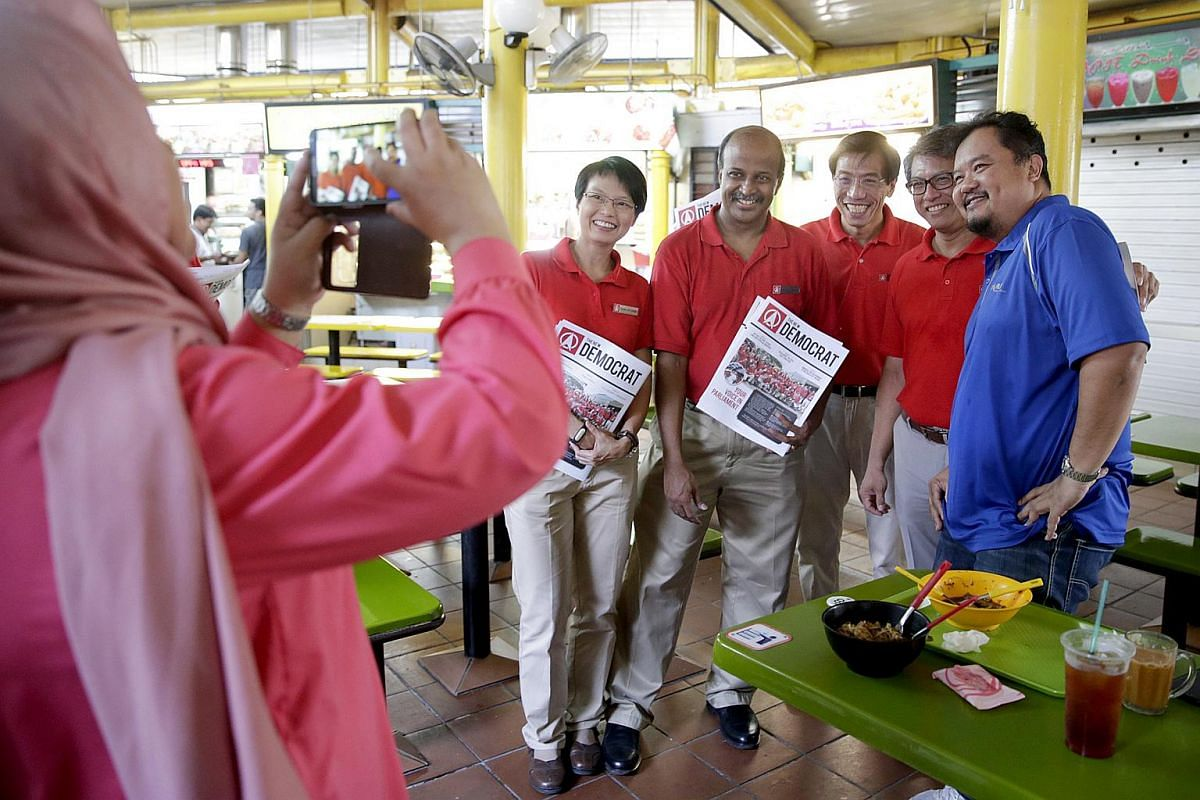 Singapore Democratic Party candidates for Holland-Bukit Timah GRC - (from left) Ms Chong Wai Fung, Dr Paul Tambyah, secretary-general Chee Soon Juan and Mr Sidek Mallek - campaigning in the area of Farrer MRT, Empress Road Market, and Adam Road Food