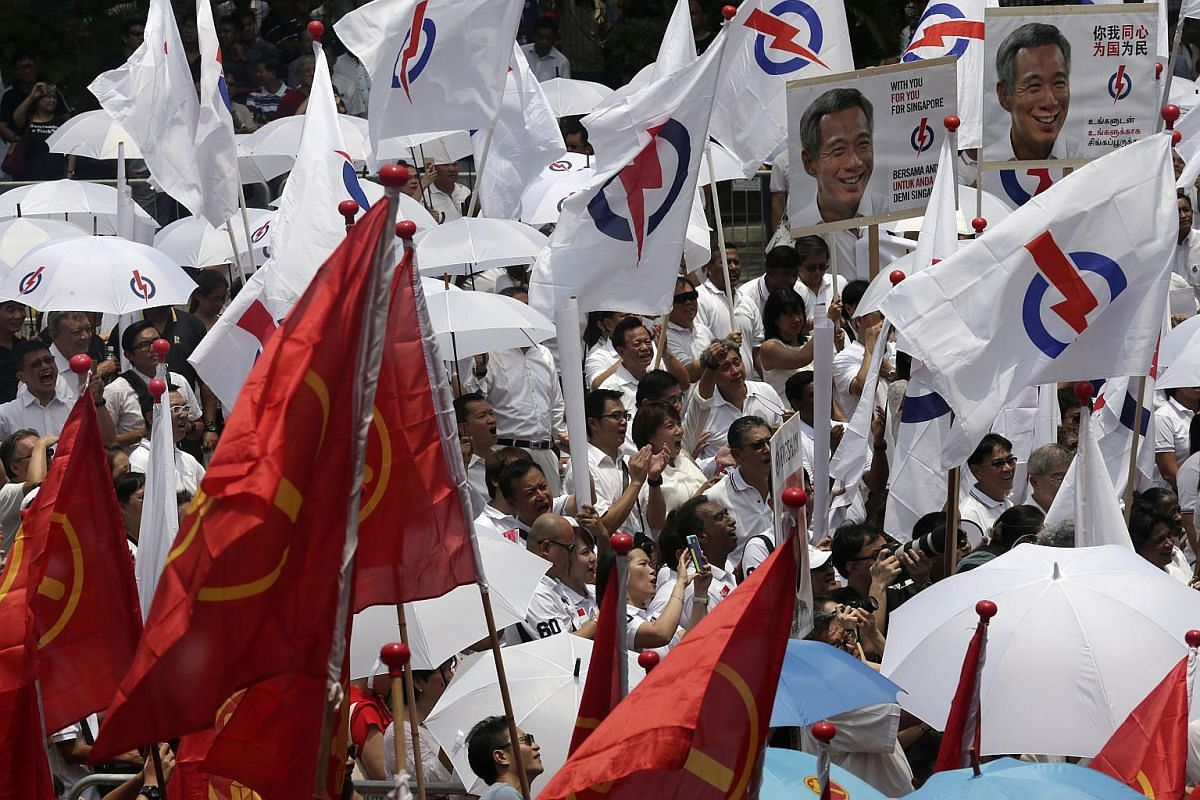 People's Action Party supporters cheer during the candidates' speeches at Fengshan Primary School.