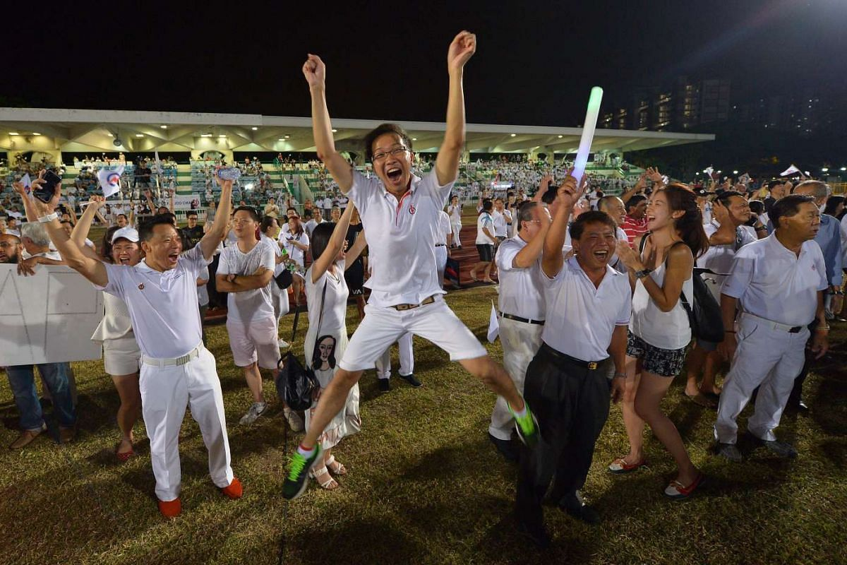 Kenneth Wong, 30, a People's Action Party activist with Marine Parade GRC, jumps for joy.