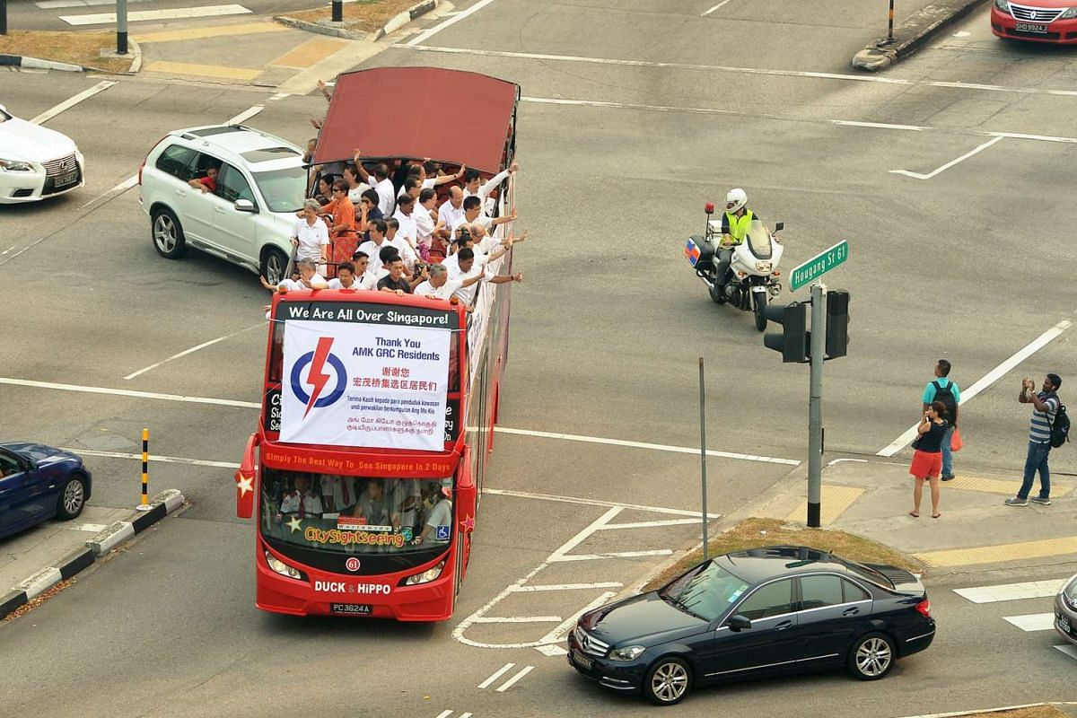 Prime Minister Lee Hsien Loong and his team making their way around Ang Mo Kio GRC on an open-top bus to thank voters for their support on Sept 12, 2015.