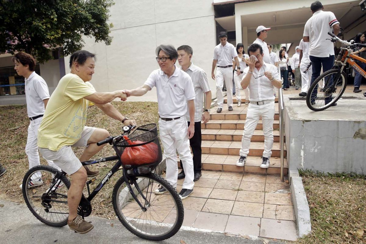 MP-elect for East Coast GRC Mr Lim Swee Say gets a congratulatory handshake from a resident during a thank you walkabout along Bedok North Street 1 on Sept 12, 2015.