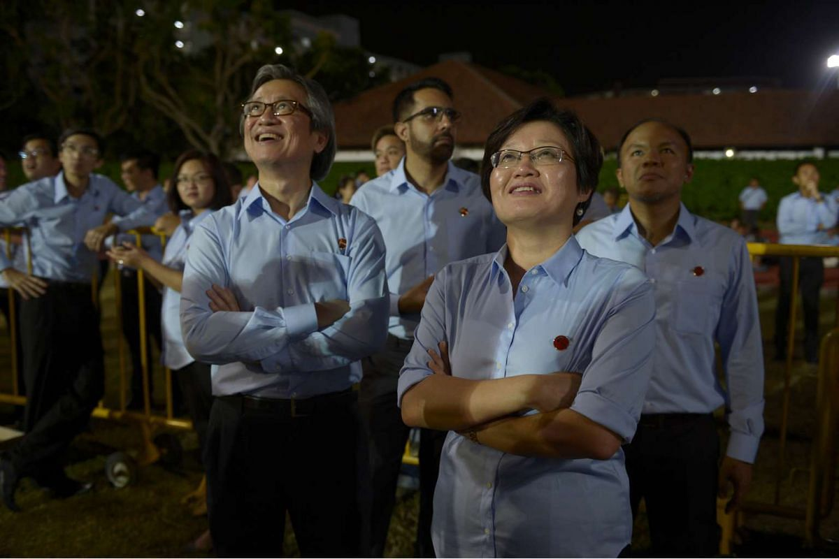 Candidates for Workers' Party Aljunied GRC (from left) Chen Show Mao, Pritam Singh, Sylvia Lim and Faisal Manap watching the announcement of the Aljunied GRC polling results backstage at Hougang Stadium on Sept 11, 2015.