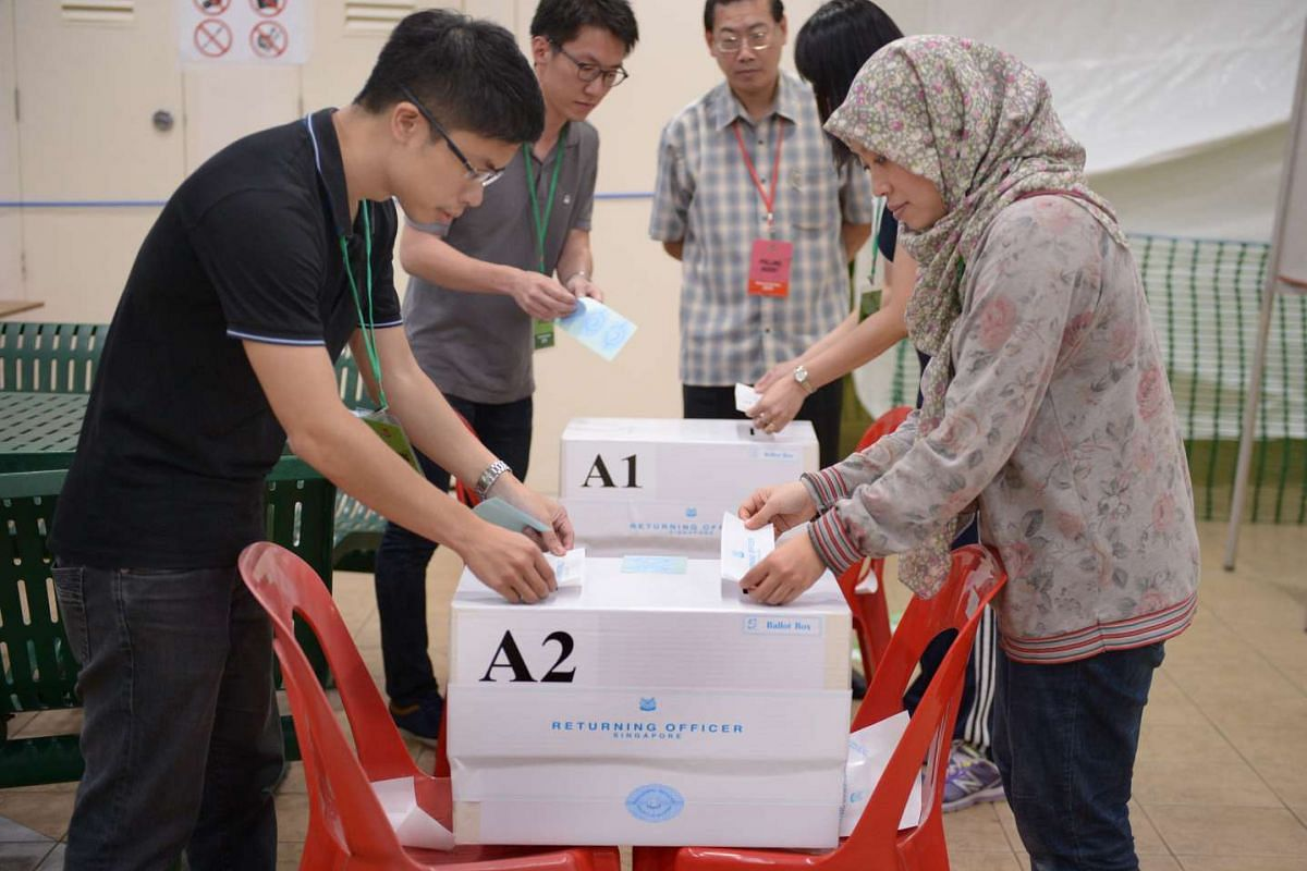 Sealing of ballot boxes at the polling station located at Block 62B Toa Payoh Lorong 4 on Sept 11, 2015. The boxes were loaded on a bus to the counting centre.