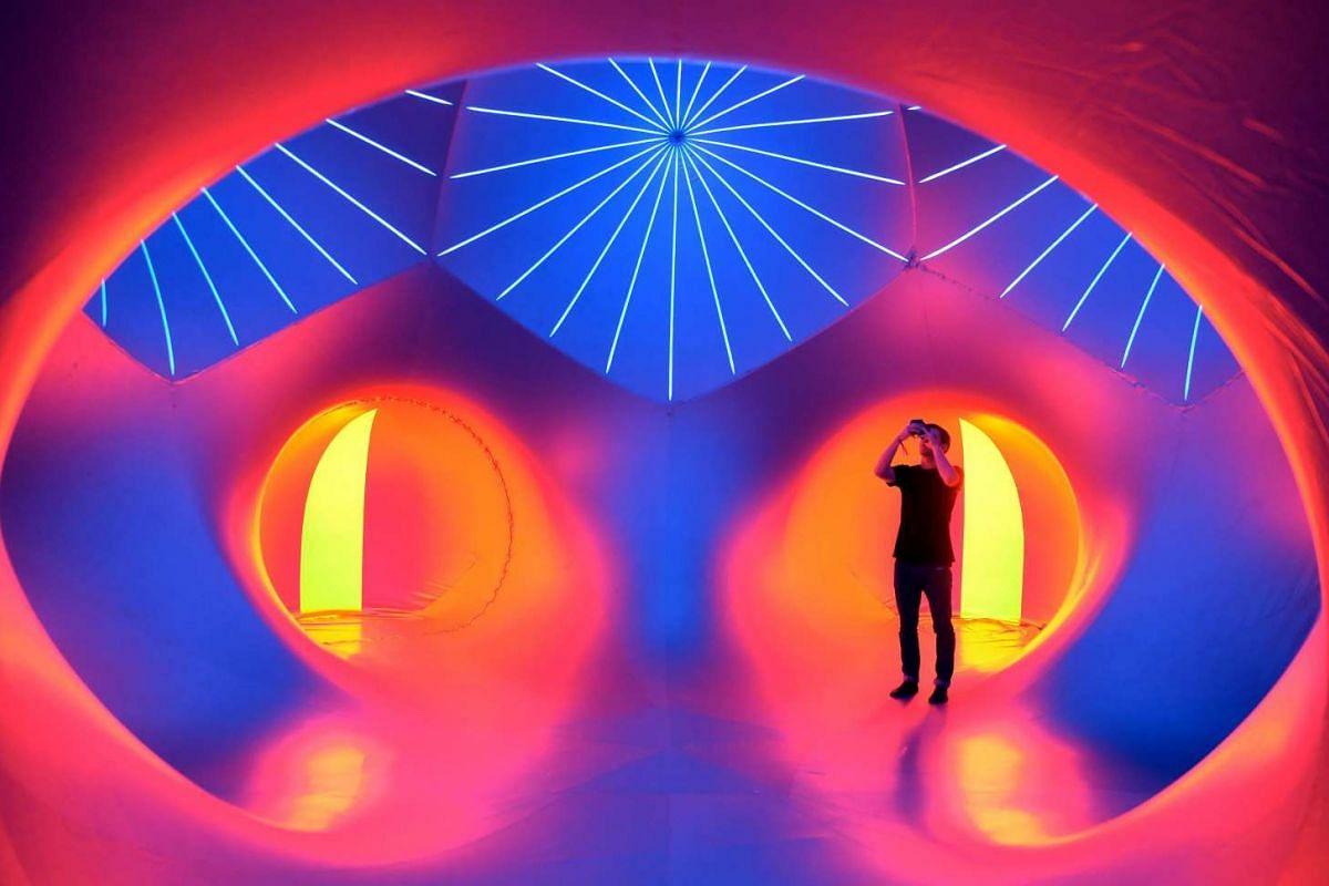 A visitor admiring the 'luminarium' - an interactive walk-in sculpture maze - at the Lollapalooza festival in Berlin, Germany, on Sept 13, 2015.