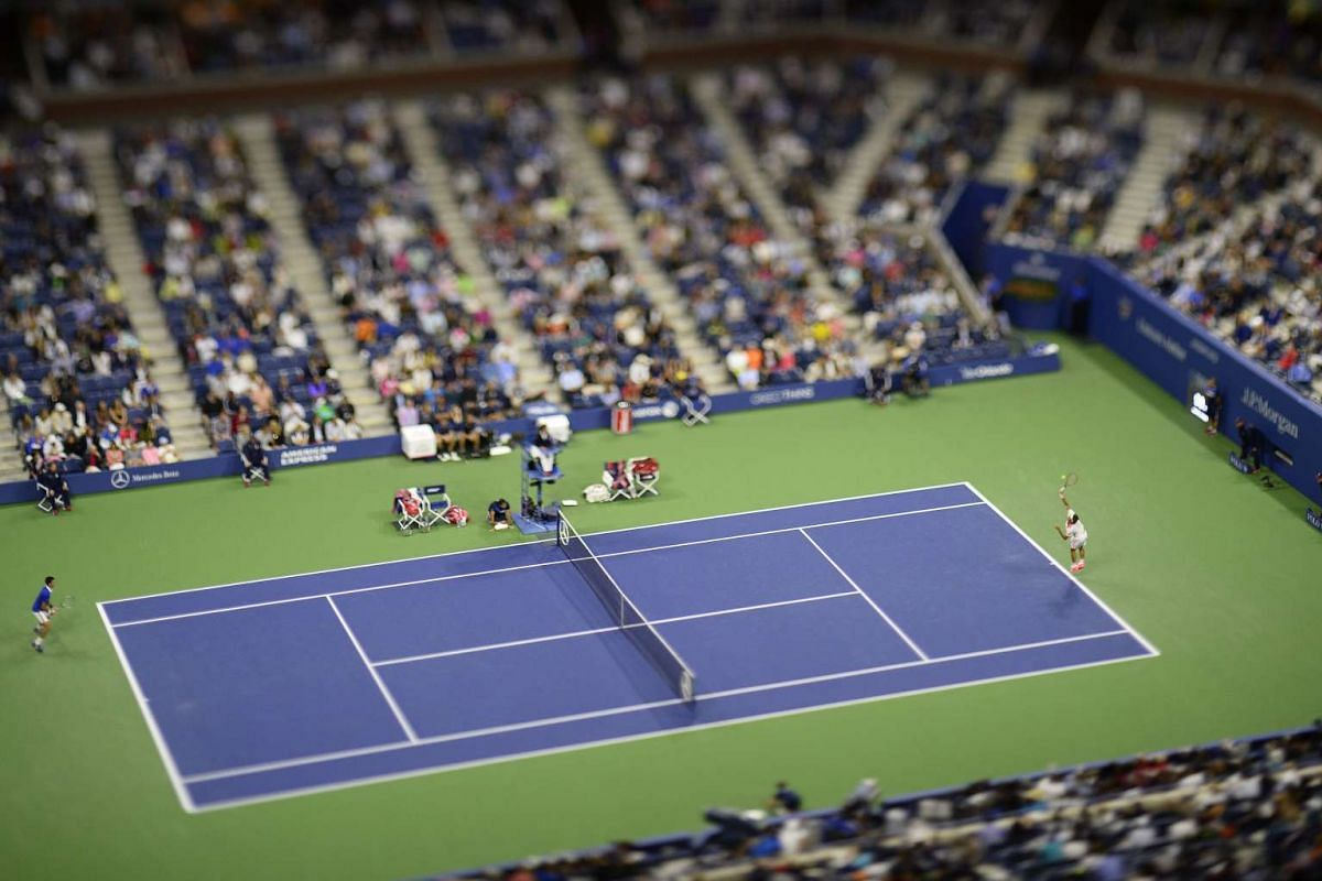 An image made with a tilt-shift lens shows Switzerland's Roger Federer serving to Serbia's Novak Djokovic during the men's final of the 2015 US Open Tennis Championship at the USTA National Tennis Center in Flushing Meadows in New York on Sept 13, 20