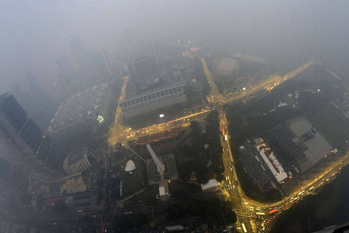 The view of the F1 circuit taken in hazy conditions at around 7pm from the 65th floor of Swissotel The Stamford on Sept 14, 2015.