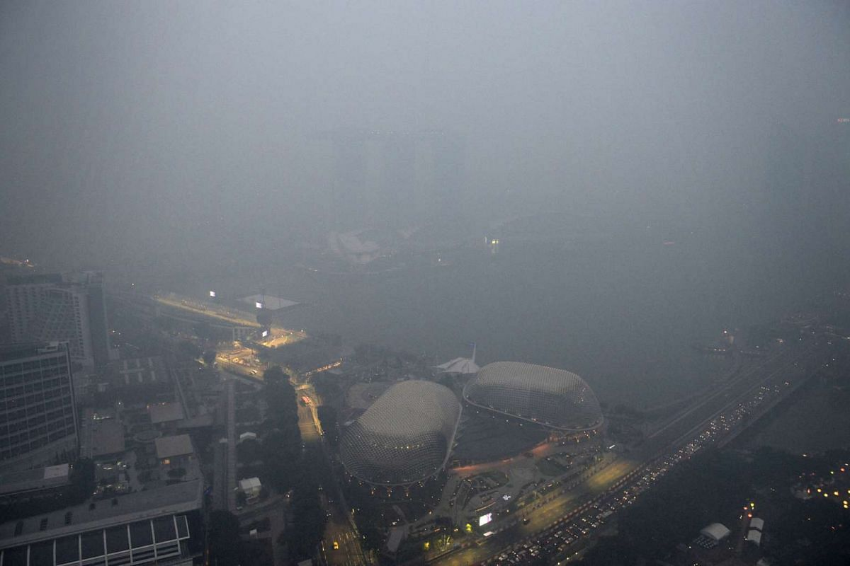 The view of the Esplanade and a barely visible Marina Bay Sands taken at around 7pm from the 65th floor of Swissotel The Stamford on Sept 14, 2015.