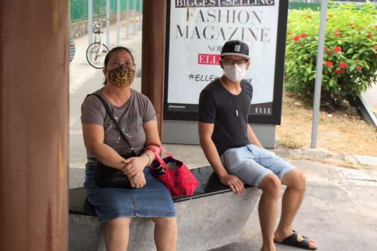 Commuters with masks spotted at bus stop along Guillemard Road.