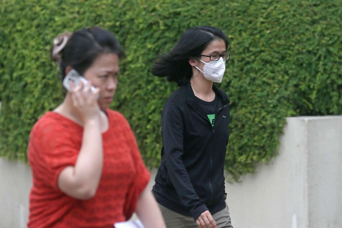 Hazy conditions on Sept 14, and people are seen wearing masks at Toa Payoh Central, as 3-hour PSI readings exceed 100 in the Unhealthy level during late afternoon.