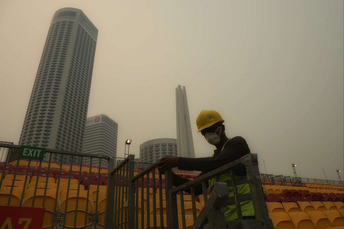 A worker from Pico Art wearing a mask while working at the Stamford Grandstand along Nicoll Highway.