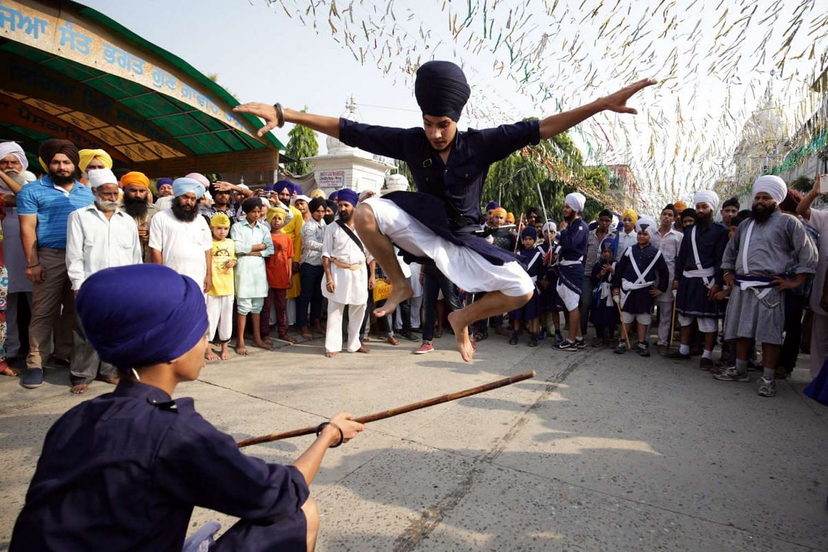 A Sikh man performs Gatka, an ancient Sikh martial art, during a religious procession in Amritsar, India, on Sept 14, 2015.