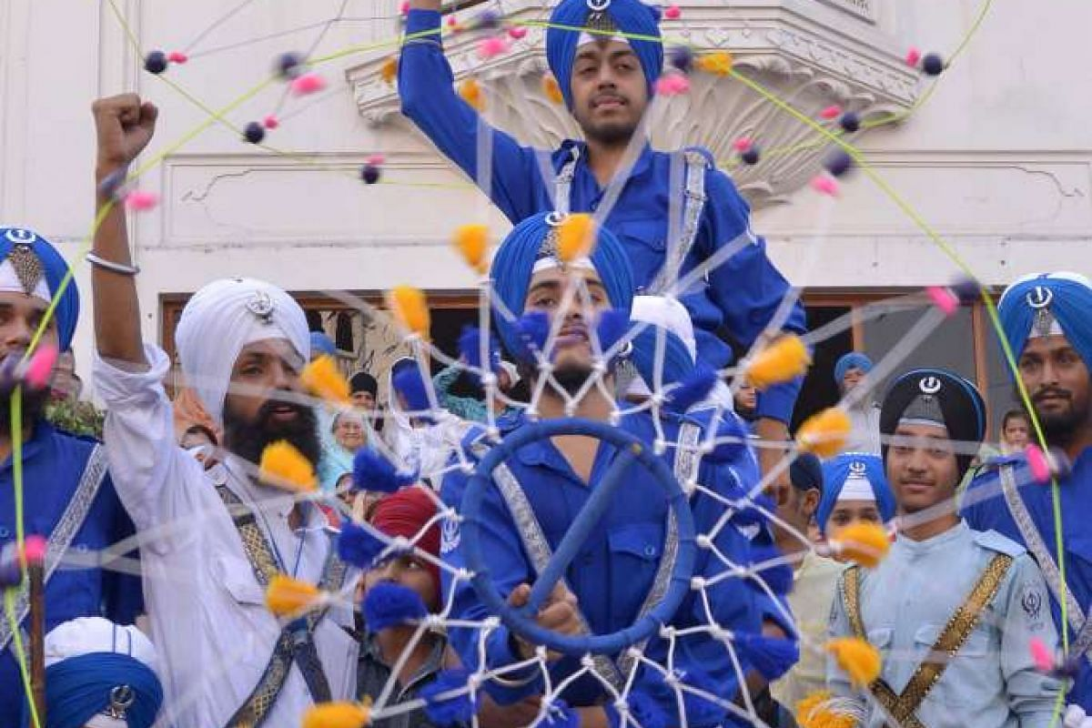Indian Nihang, religious Sikh warriors, show their skills in the Sikh martial art Gatka during a religious procession from Gurudwara Ramsar to Akal Takht Sahib to mark the 411th anniversary of the installation of the Guru Granth Sahib, the Sikh Holy
