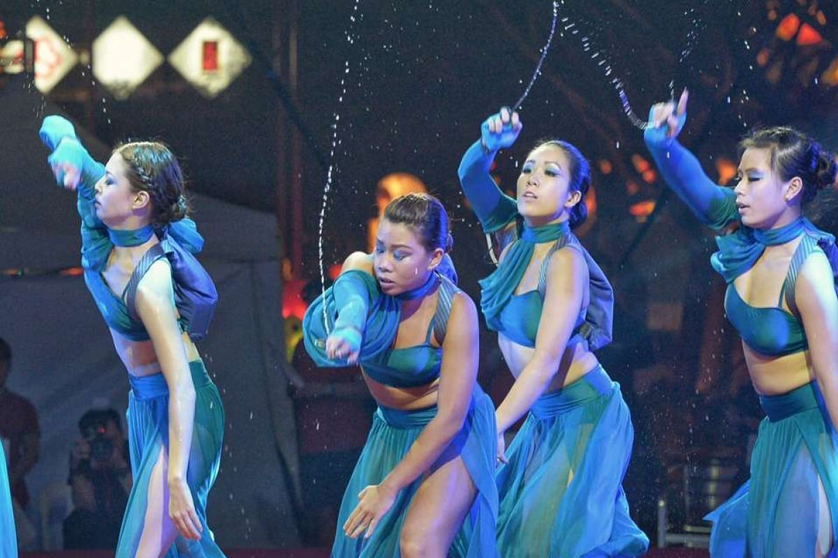 Dancers from Wildfire Entertainment & Performing Arts Association of Singapore performing in the second of eight acts titled A Tropical Shower In Singapore, which incorporates water elements as props.