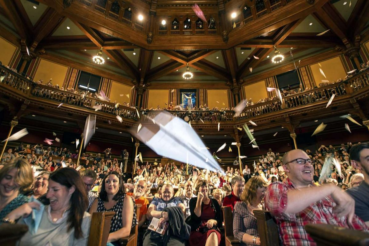 Spectators throw hundreds of paper airplanes at the stage during the 25th annual Ig Nobel awards held in Sanders Theatre at Harvard University in Cambridge, Massachusetts, USA, 17 September 2015. The Ig Nobel Prizes honor achievements that make peopl