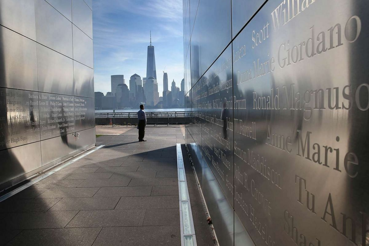 An immigrant from Colombia walks through the New Jersey Empty Sky 9/11 Memorial at Liberty State Park on September 17, 2015 in Jersey City, New Jersey. The group, representing 30 countries, took the oath of allegiance to the United States on U.S. Cit