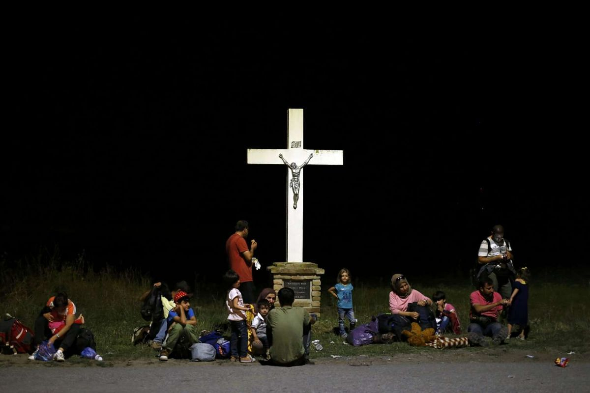 Migrants waiting near the train station in the Croatian town of Tovarnik on Sept 17, 2015.