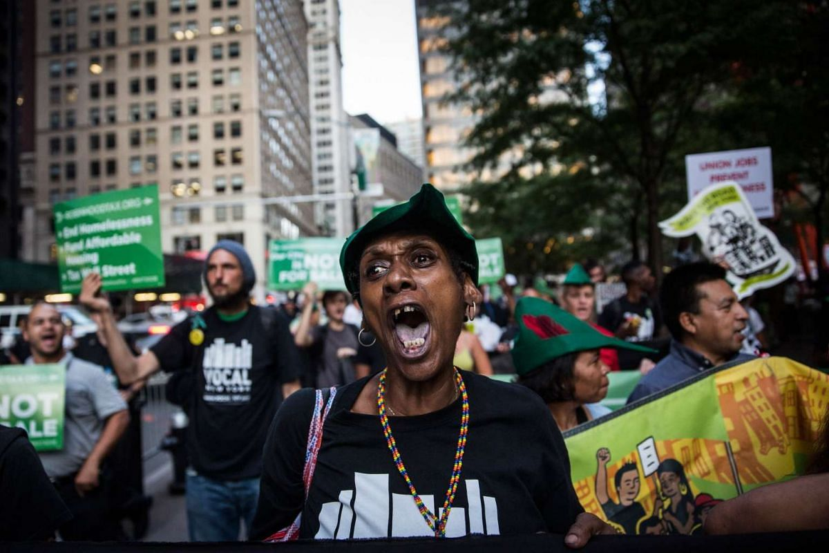 Housing activists march from Zuccotti Park to New York City's City Hall to demand more affordable housing options for the homeless and poor on September 17, 2015 in New York City. PHOTO: GETTY IMAGES / AFP /  ANDREW BURTON
