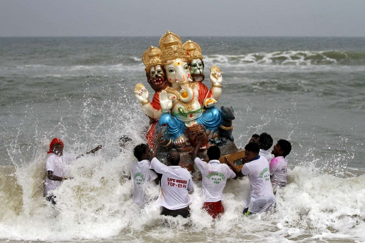 Devotees carrying an idol of the Hindu god Ganesh, the deity of prosperity, into the Bay of Bengal for its immersion during the 10-day-long Ganesh Chaturthi festival in Chennai, India, on Sept 20, 2015.