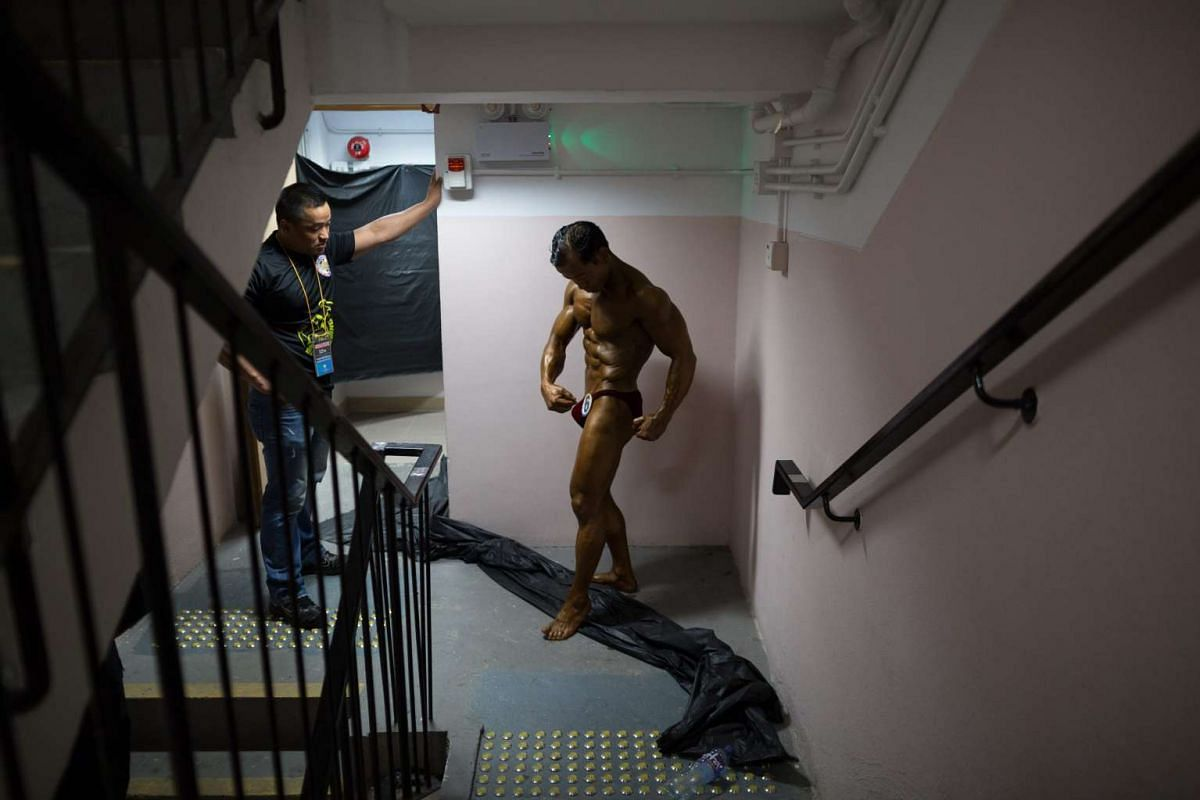 Participants warming up backstage during the Mr Hong Kong Nepal 2015 bodybuilding competition, in Hong Kong on Sept 20, 2015. The members of the Hong Kong Nepalese Bodybuilding Association hope their sport can inspire other young Nepalis and help ove