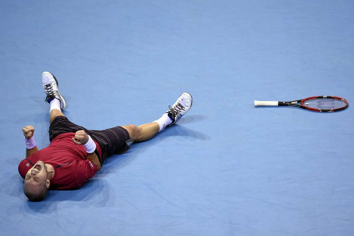 Belgian Steve Darcis reacting after winning the Davis cup semi-final against Argentinian Federico Delbonis at the Forest National Arena on Sept 20, 2015. AFP PHOTO/JOHN THYS