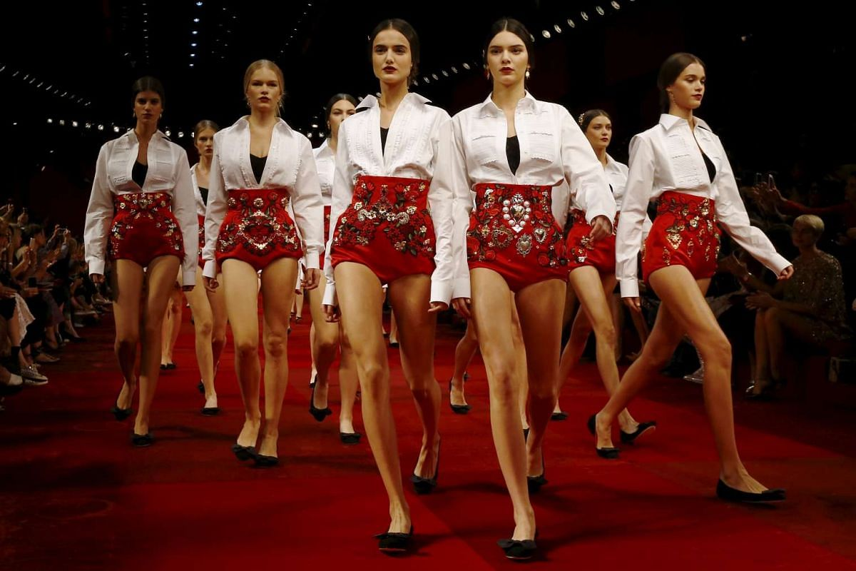 Models, including reality TV star Kendall Jenner, presenting creations from the Dolce & Gabbana Spring/Summer 2015 collection during Milan Fashion Week, Italy. Milan Fashion Week begins this week.