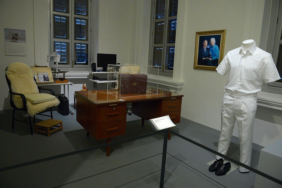 Mr Lee Kuan Yew's white shirt and trousers in the 1960s (right), writing table (centre) and other furniture.