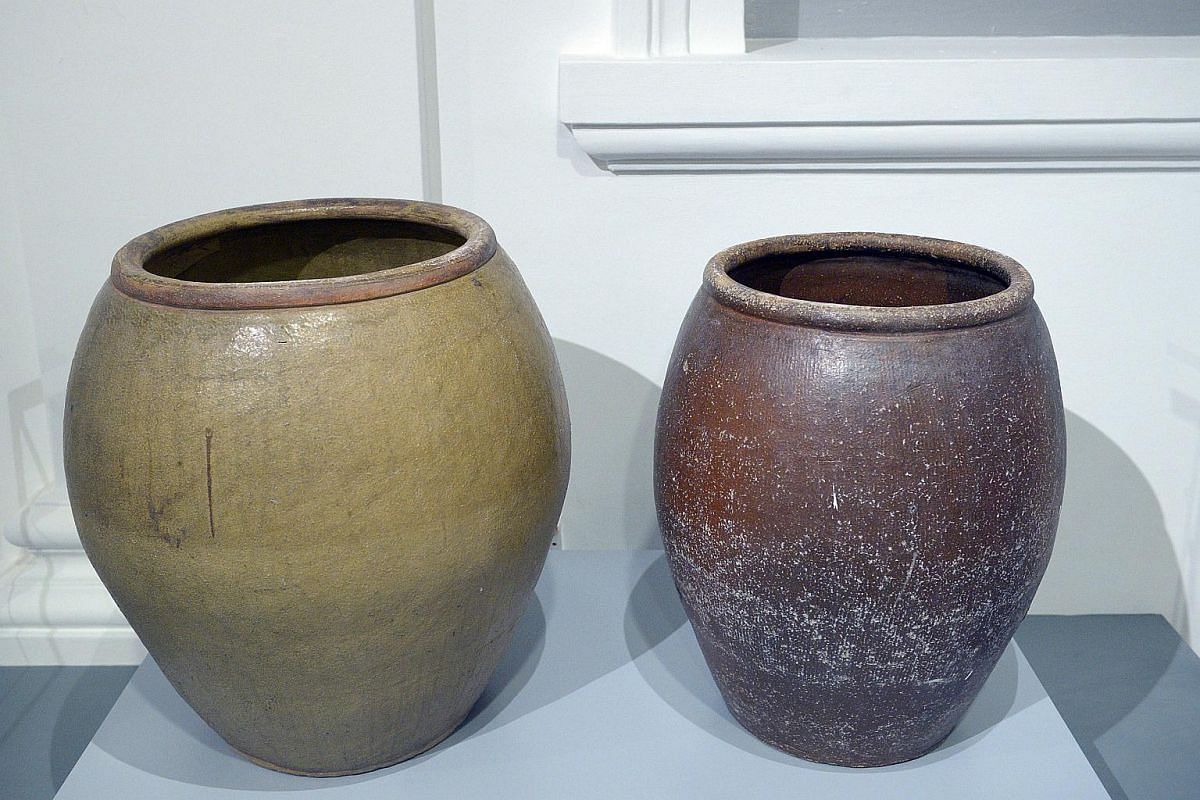 Two earthenware storage jars (mid-20th century) which were used in the bathroom of Lee Kuan Yew's Oxley Road home. The family bathed with water stored in these jars well into the 21st century. A modern heater was installed after Mrs Lee suffered her