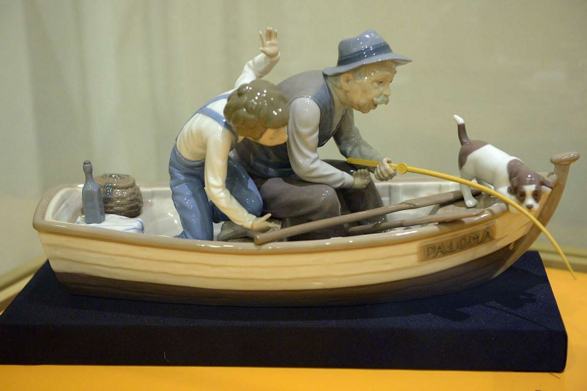 Lladro handmade figurine titled Fishing With Gramps 1993.