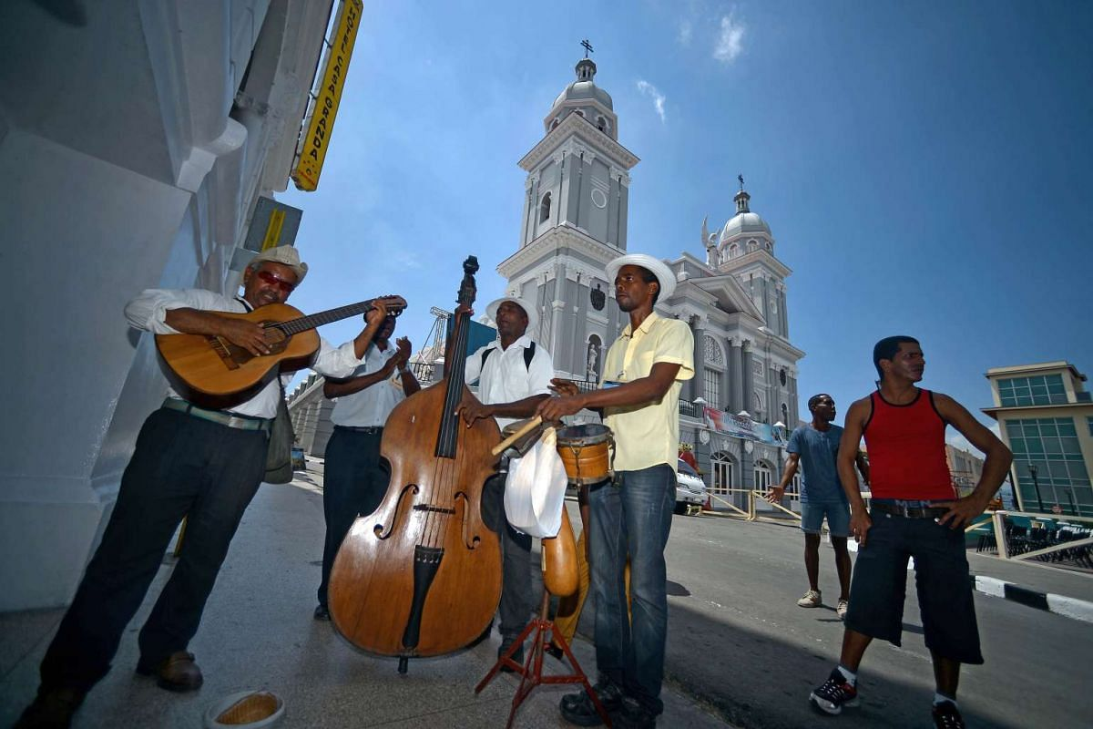 Musicians preparing to play in Santiago de Cuba, before the arrival of Pope Francis on Sept 21, 2015. Santiago, the last stop on Pope Francis's Cuban tour, is known for its revolutionary history, its rum and the troubadours who have infused the Carib