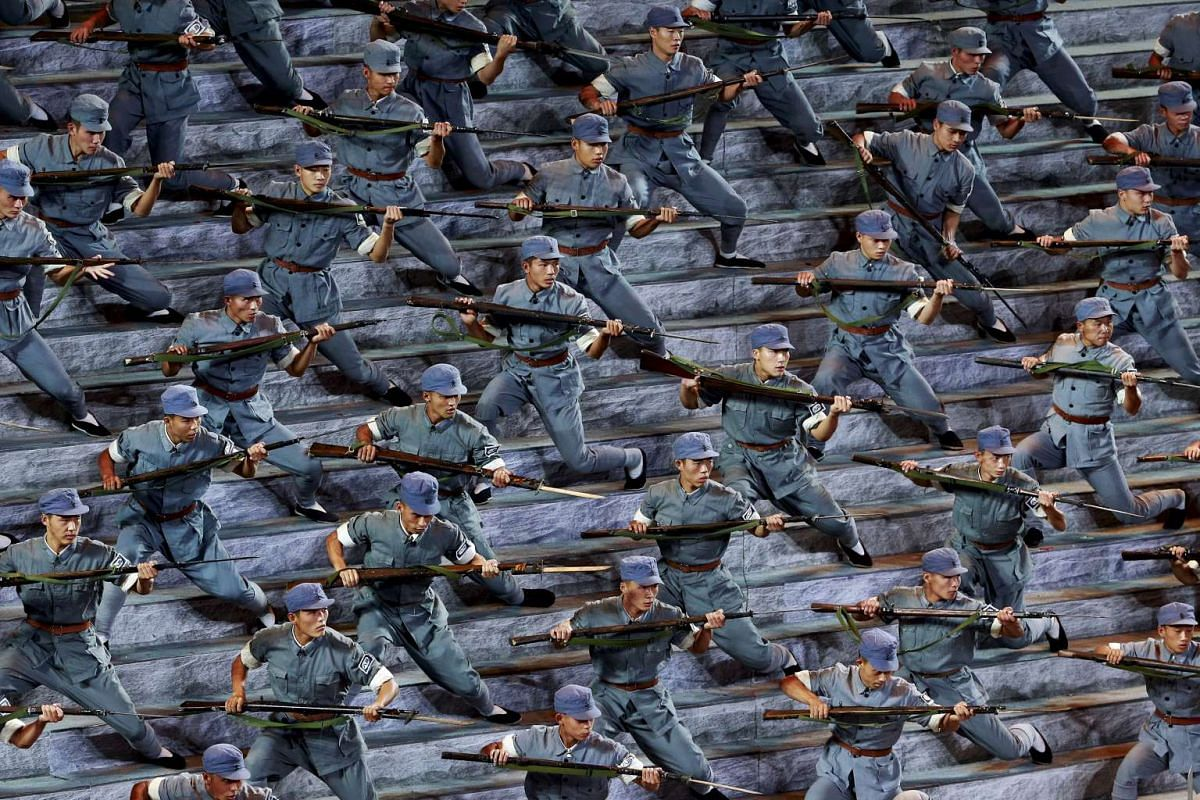 Actors dressed as Red Army soldiers performing at a gala show to mark the 70th anniversary of the end of World War II, in Beijing, China, in this Sept 3, 2015 file photo. Bitterness is growing within China's armed forces to President Xi Jinping's dec
