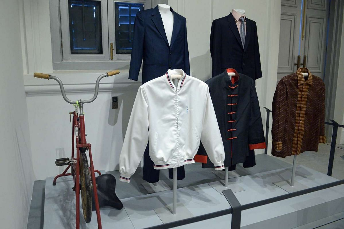 Clothes worn by Mr Lee Kuan Yew. Pictured also is his red exercise bike which he had used for more than a decade.