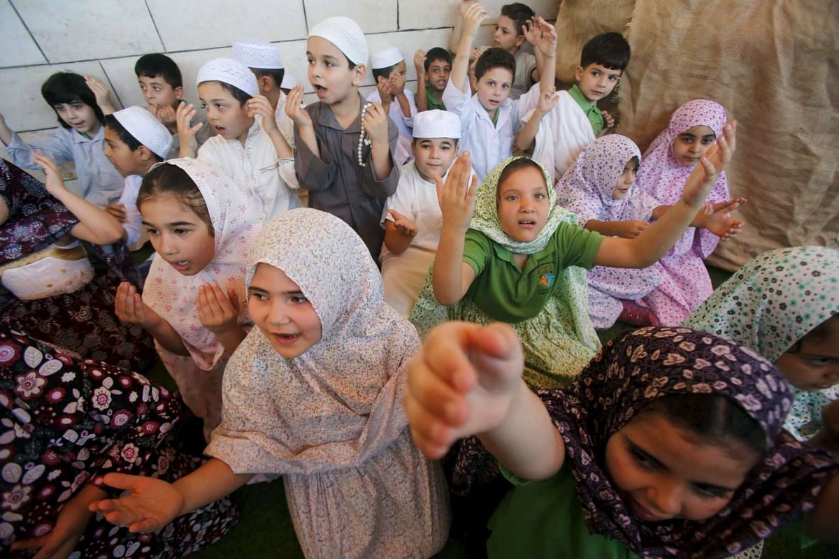 Palestinian children taking part in a re-enactment of the annual haj pilgrimage to Mecca, at their school in the West Bank city of Nablus on Sept 22, 2015.