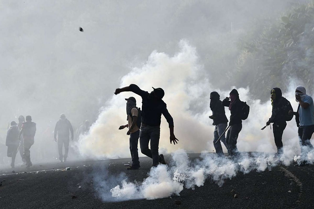 Student teachers from Ayotzinapa angry for the disappearance of 43 students clash with the riot police along the Tixtla-Chilpancingo highway in Tixtla, Guerrero State, Mexico, on September 22, 2015. Its almost a year since the teachers-in-training va