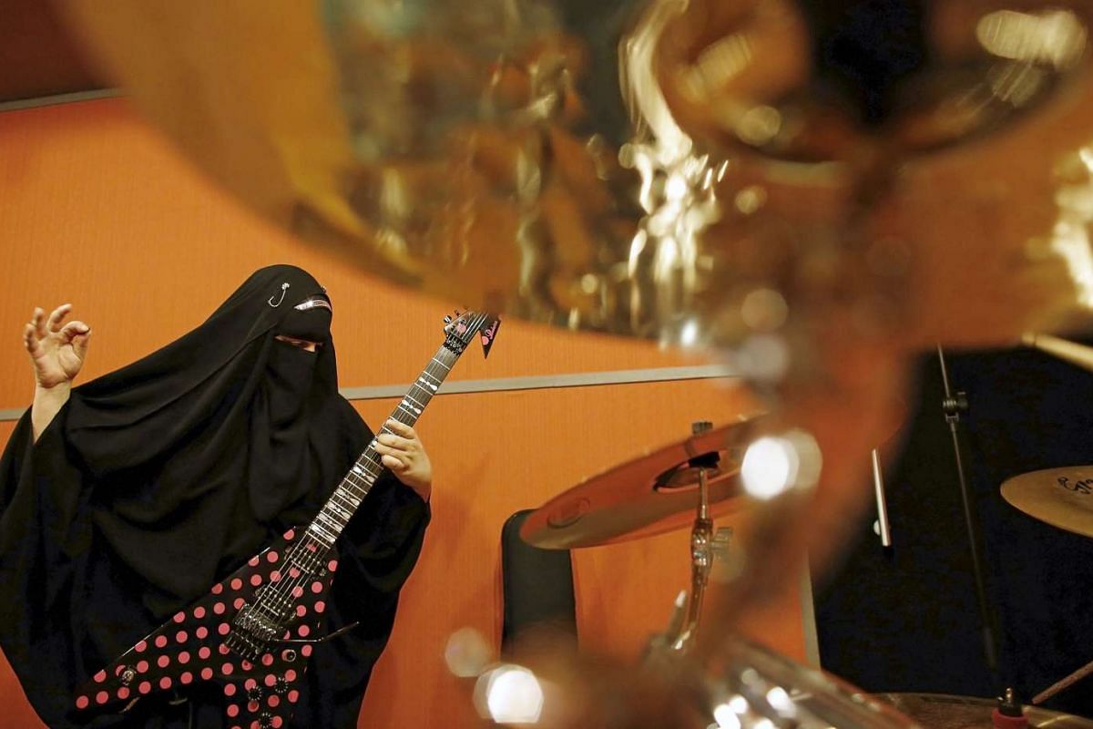 Gisele Marie, a Muslim woman and professional heavy metal musician, plays her Gibson Flying V electric guitar during a rehearsal at a studio in Sao Paulo. Based in Sao Paulo, Marie, 42, is the granddaughter of German Catholics, and converted to Islam