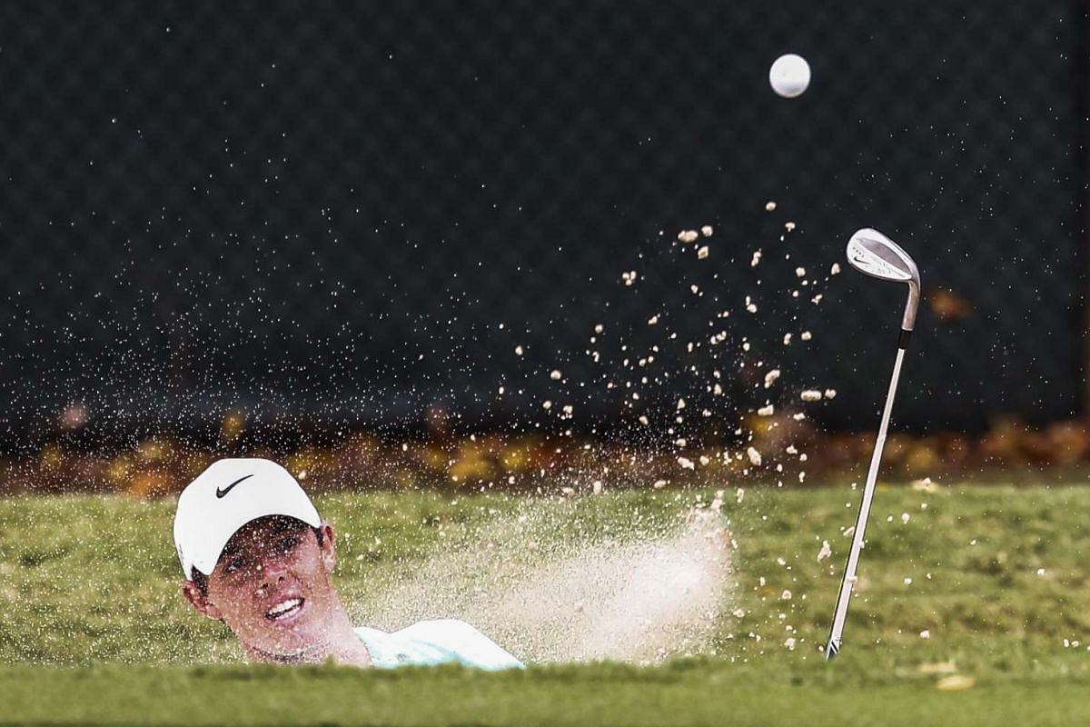 Rory McIlroy of Northern Ireland hits from a sand trap by the second green in the first round of the TOUR Championship golf tournament at East Lake Golf Club in Atlanta, Georgia, USA on 24 September 2015. The TOUR Championship is the fourth and final