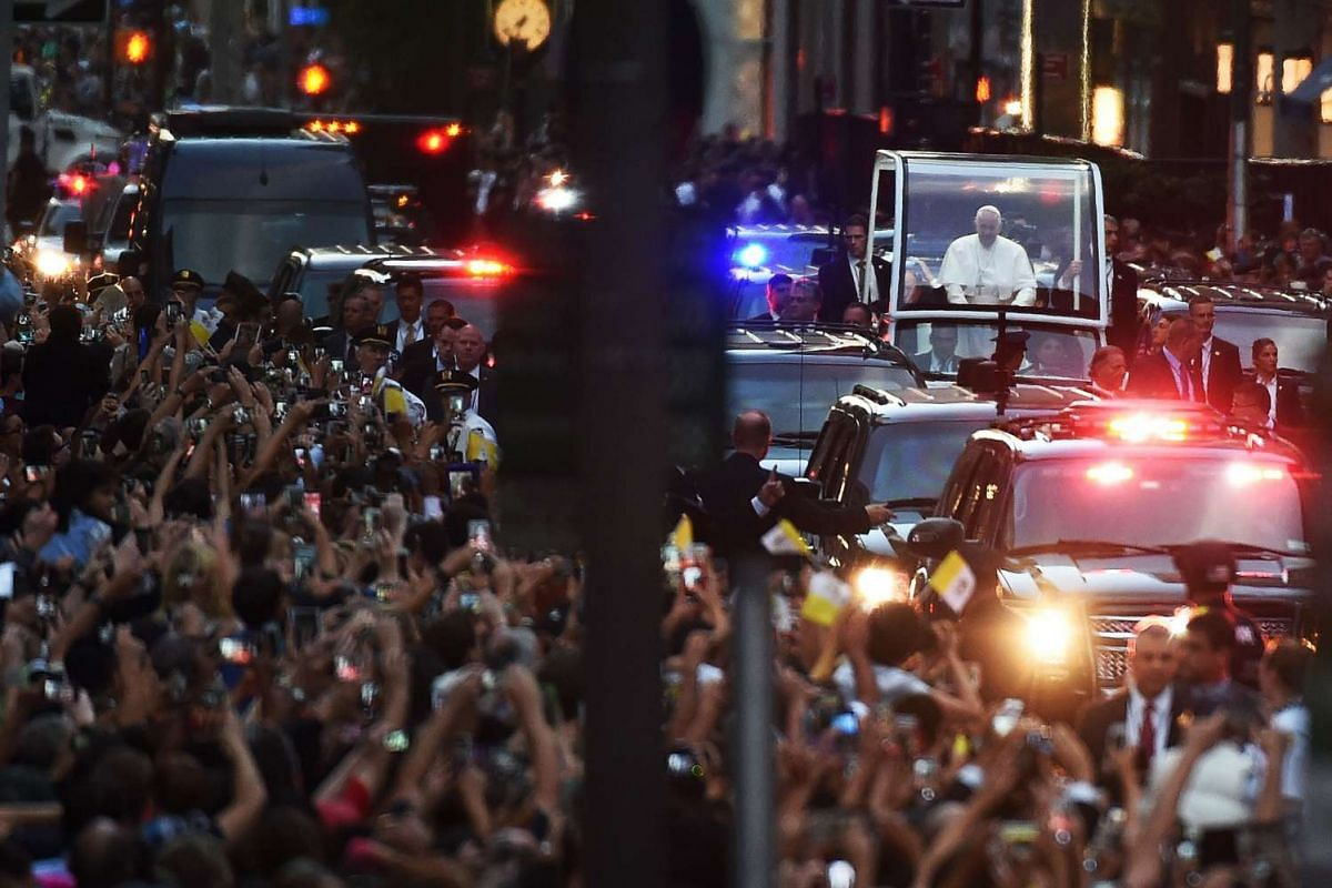 Pope Francis approaches St. Patrick's Cathedral to lead evening prayers in New York on September 24, 2015. Pope Francis arrived in New York on the second leg of his US tour where he will address the UN General Assembly, visit the 9/11 Memorial and ce