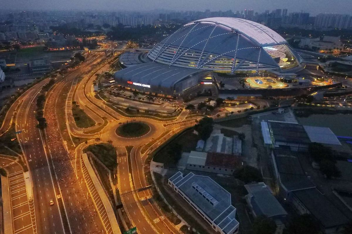 An aerial view of the runners and the Singapore Sports Hub at the flag-off for the 10km race at around 6.30am.
