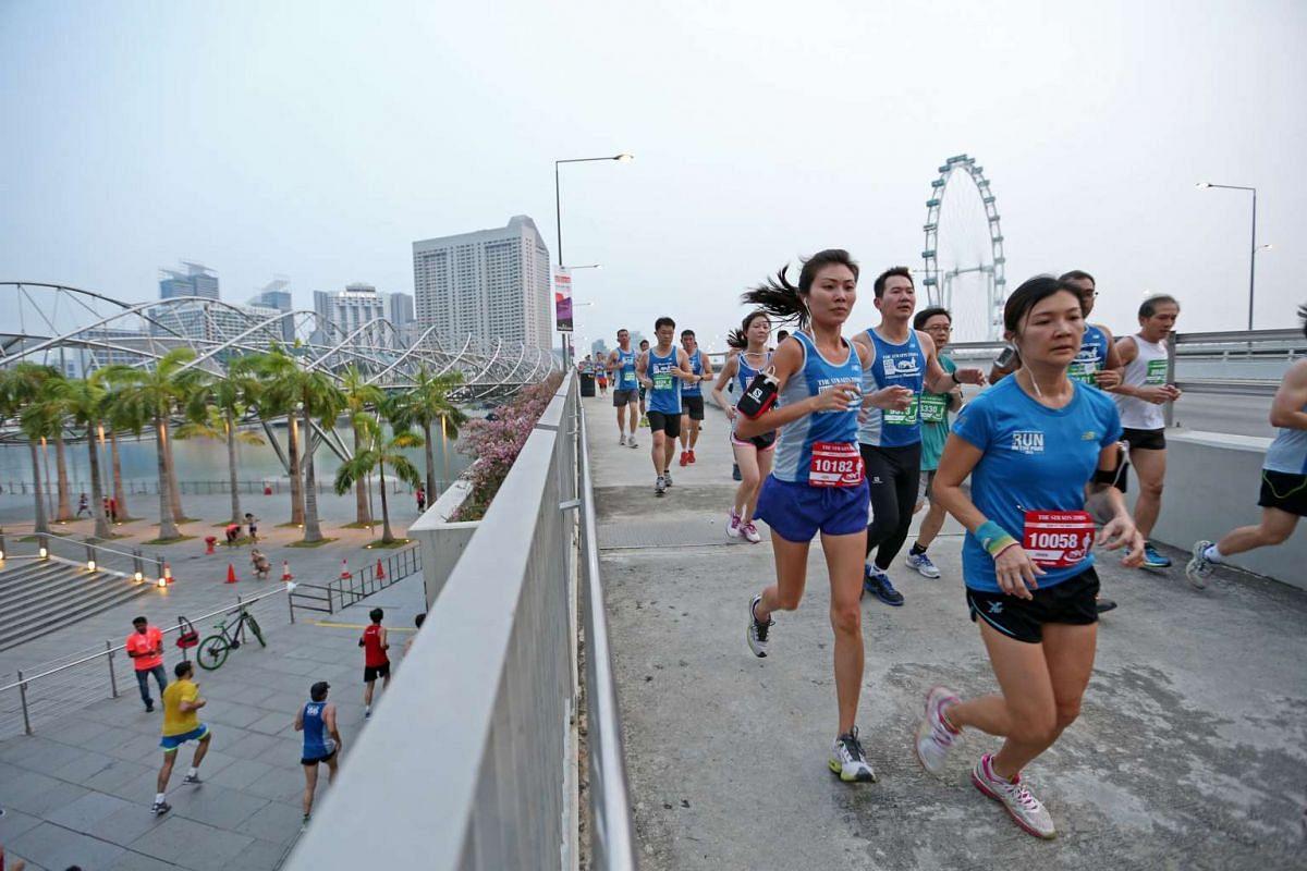 Participants of the 10km race running near Marina Bay Sands.