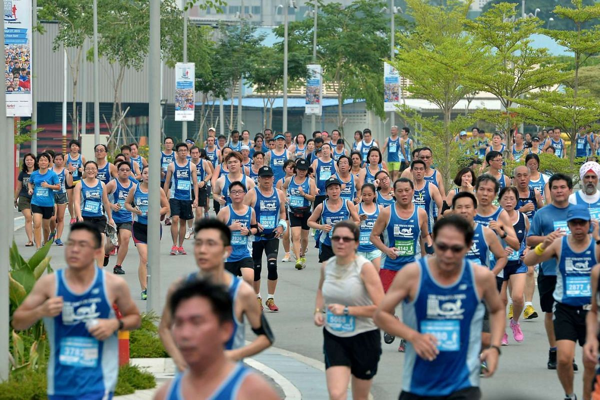 Participants of the 5km race arriving at the Sports Hub.