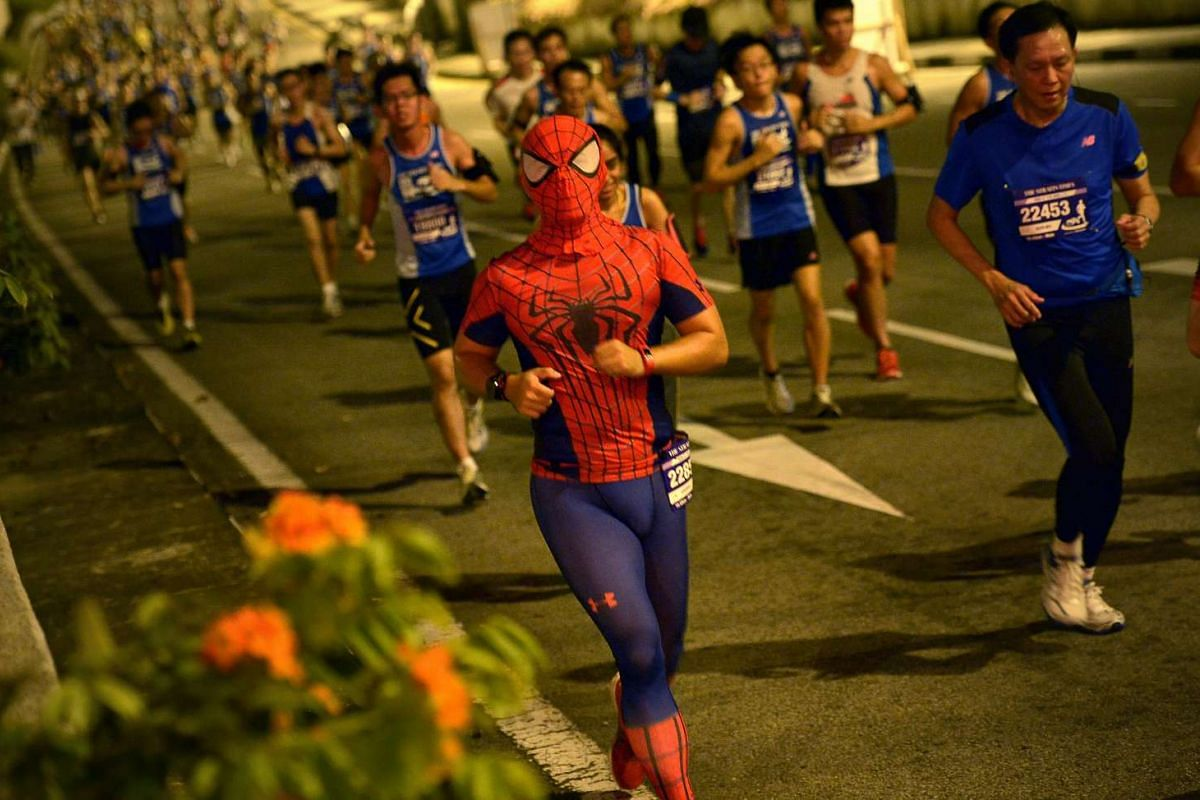 One of the 18.45km race participants, dressed up as Spiderman.