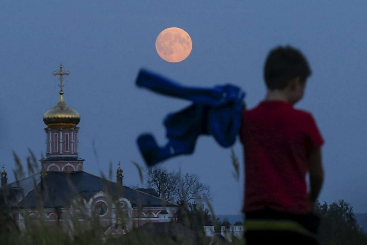 A boy walking near a local monastery in the settlement of Poschupovo in Russia's Ryazan region on Sept 27, 2015.