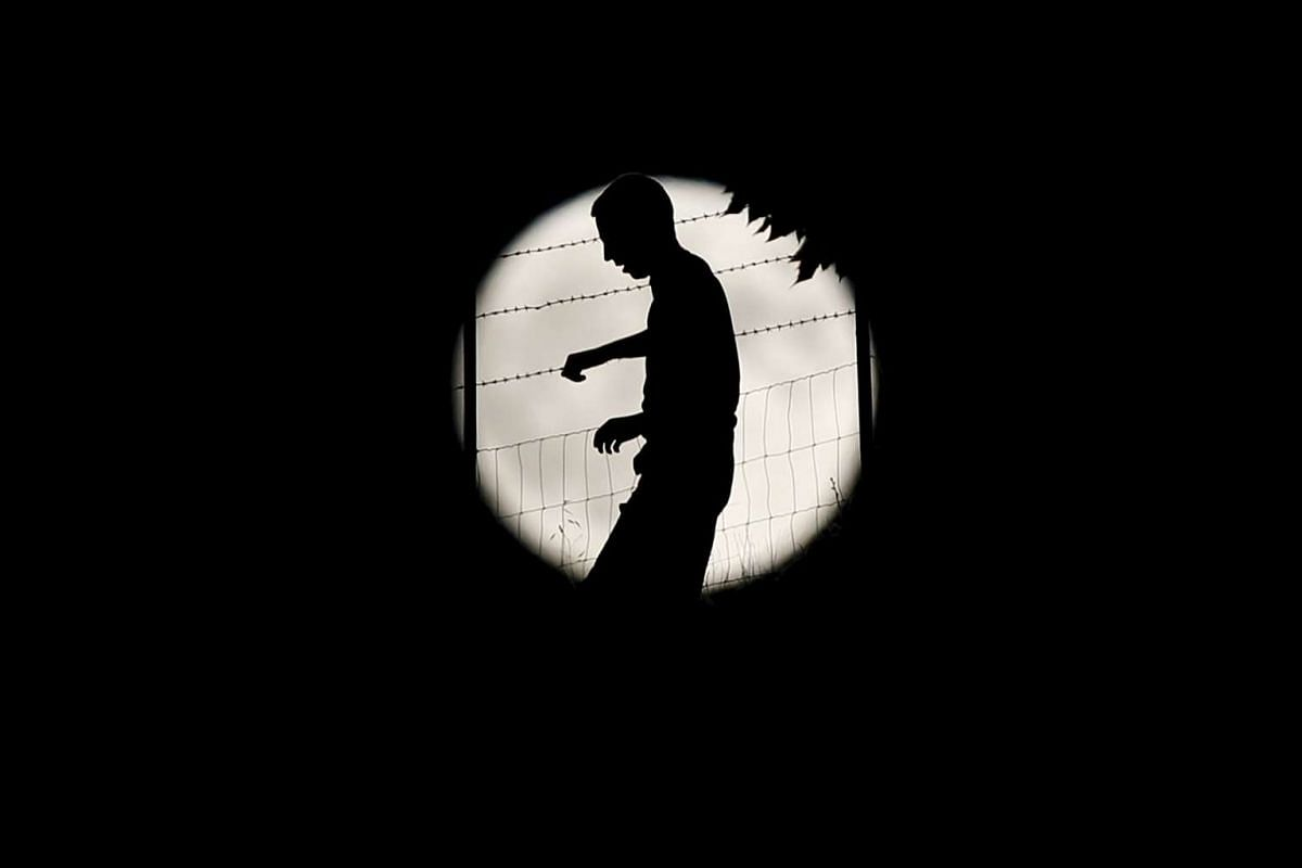 A man silhouetted against a full moon at a field in Ronda, southern Spain, on Sept 27, 2015.