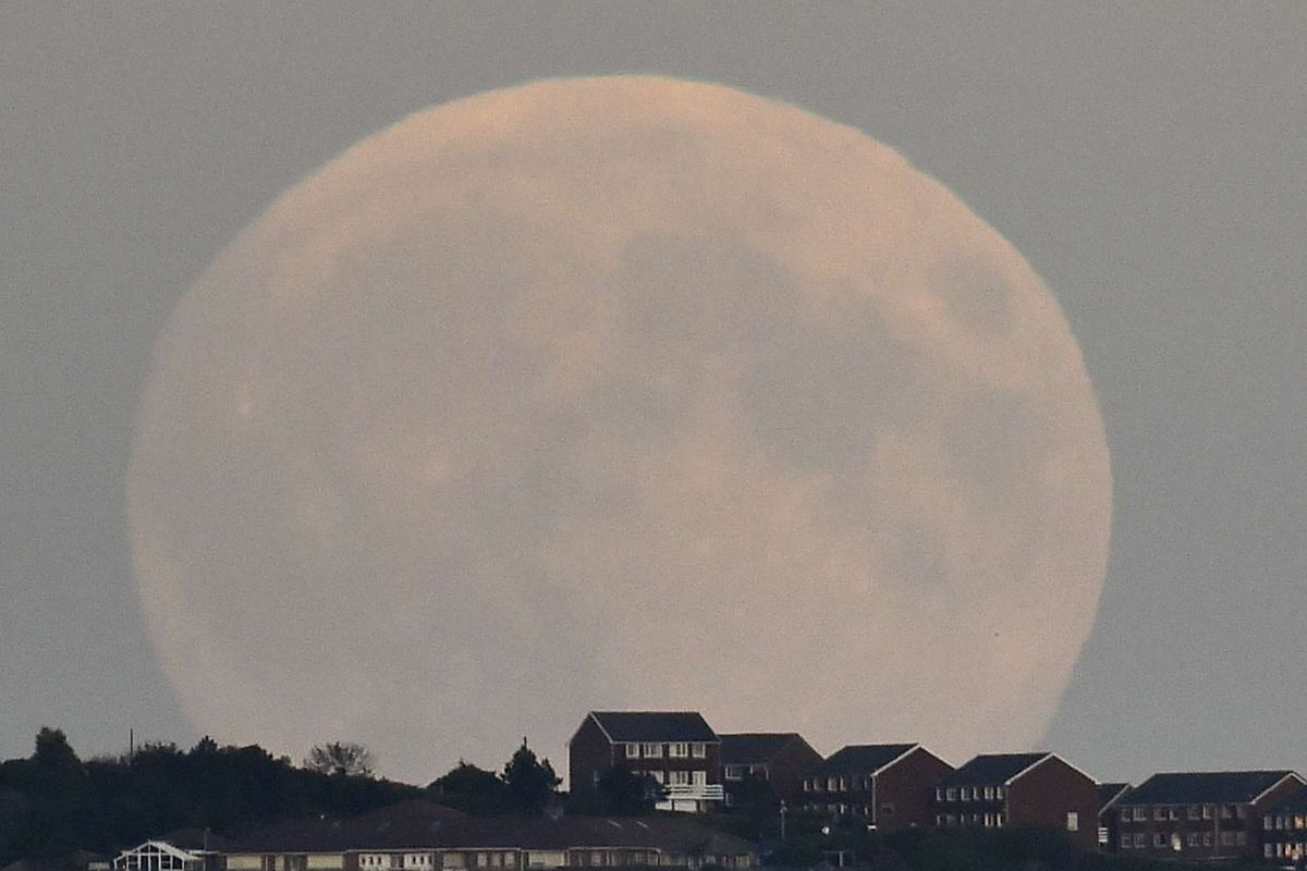 A supermoon' rising above Brighton in southern England on Sept 27, 2015.