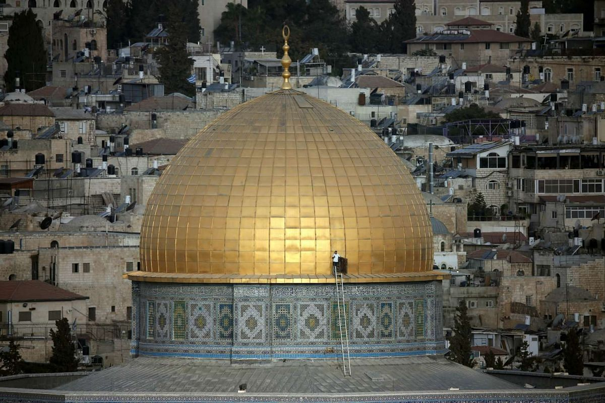 A Palestinian man stands by a door at the golden dome of the Dome of the Rock mosque on the Al-Aqsa mosque compound, in Jerusalem's Old City, on Sept 29, 2015.