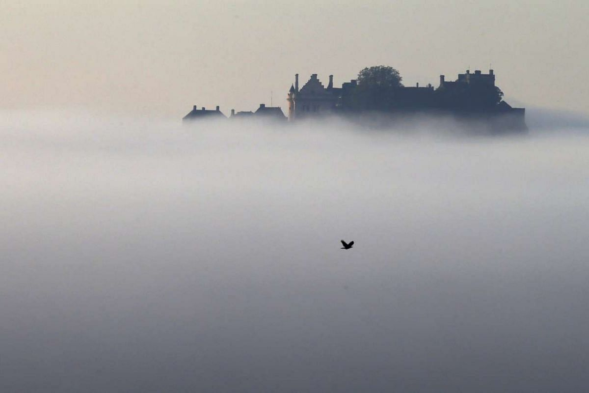 Stirling Castle is seen above morning mist, in Scotland on Sept 30, 2015.