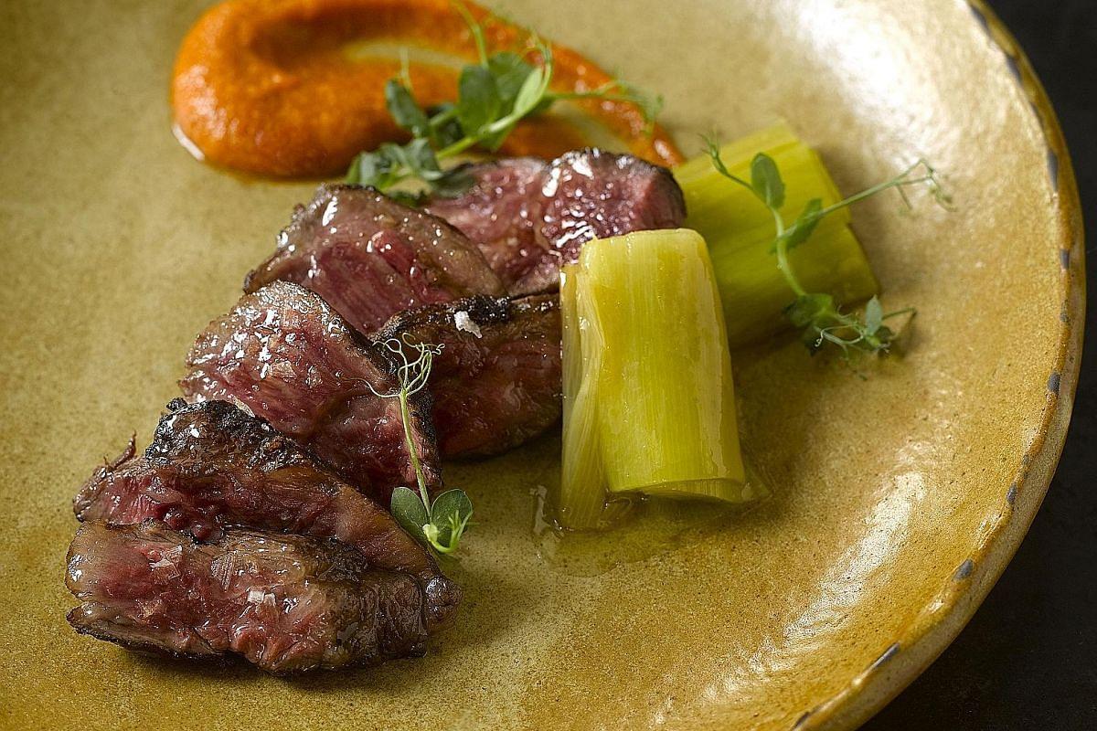 Menu highlights include Spanish Omelette, Wagyu Beef Intercostals and Spanish Nigiri (above).